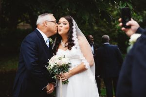 father of the bride kissing the bride